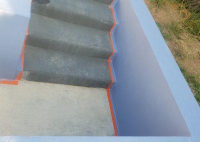 Réalisation d'un mur avec escalier et finition peinture